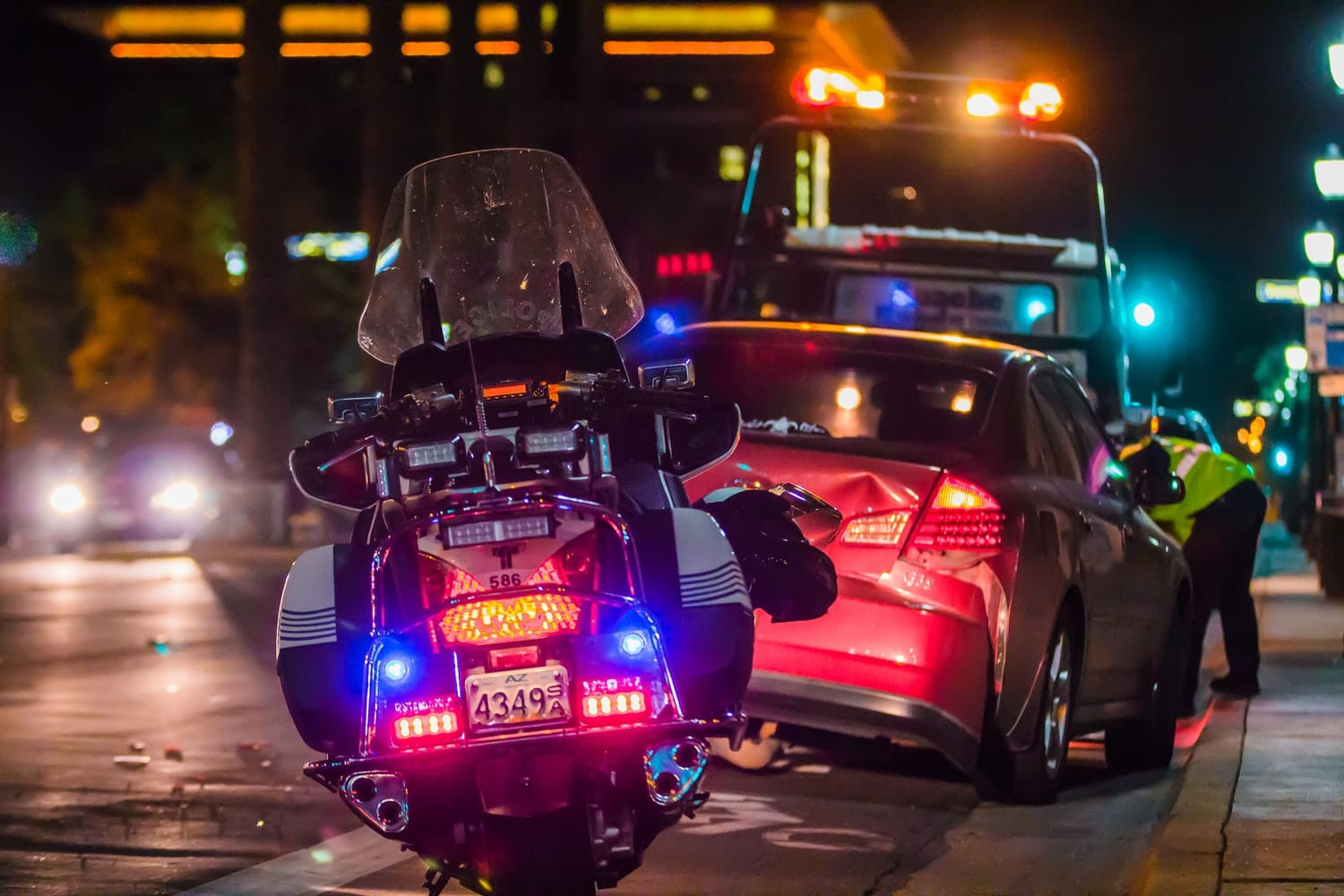 car accident with tow truck and police motorcycle