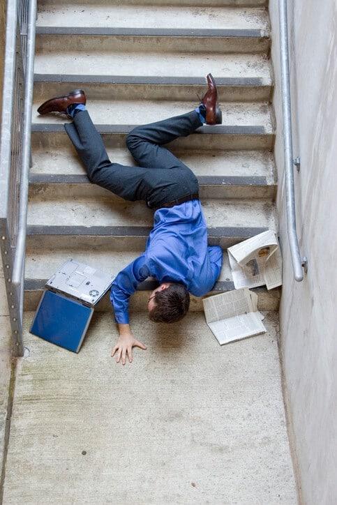 man falling down steps