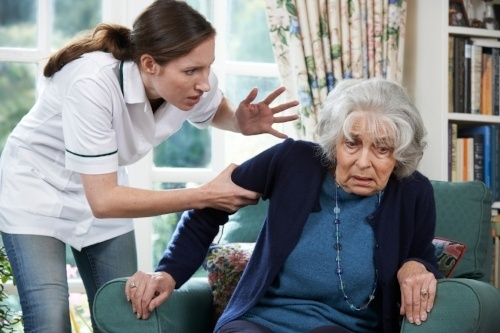 Nursing home worker abusing an elderly woman